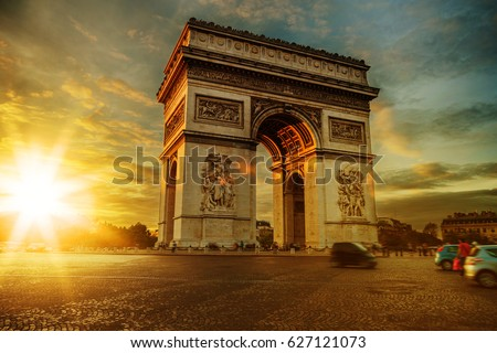 View of Arc de Triomphe, Place Charles de Gaulle and the avenue Champs-Elysees on a bright sunny summer day. Famous touristic places and romantic travel destinations in Europe. Long exposure. Toned #627121073