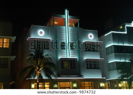 View of Art Deco Hotel lit up at Night with White Lighting