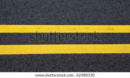 view of asphalt with distinct two yellow stripes