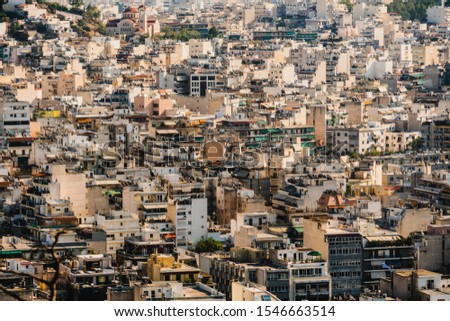 View of Athens from Acropolis with mass of houses, buildings, apartments, rooftops in the city center of Greek capital, Greece.
