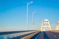 view of automobile arch bridge across the sea strait, modern design of automobile bridge with freeway