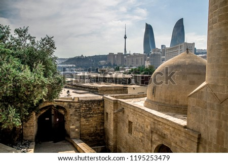 View of Baku - historical Azerbaijan capital. Old streets, ancient buildings and modern architecture.