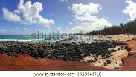 View of Baldwin Beach on Maui, Hawaii's North Shore Over the Lava Rocks on a Sunny Day