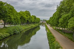 View of banks of the Somme River in Amiens. Amiens – city in northern France, in the department of the Somme region of Picardie.