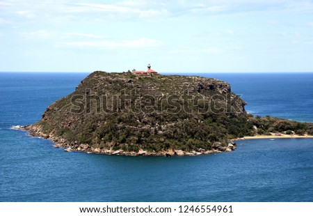 View of Barrenjoey Lighthouse on the top of Barrenjoey Head at the end of Palm beach from West Head (Ku-ring-gai Chase National Park, NSW, Australia)