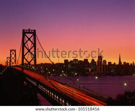 View of Bay Bridge from Treasure Island at sunset, San Francisco, California
