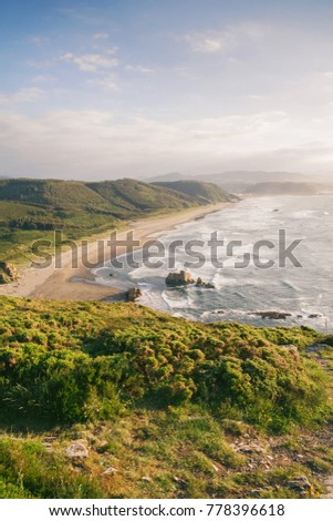 Shutterstock View of Bayas beach in a sunny day, in the coast of Bayas, Asturias, on Spain. It is the longest beach in all asturian coast.