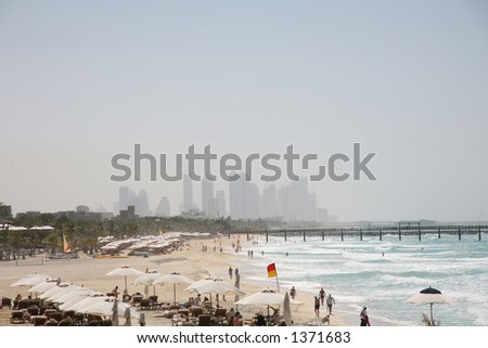 View of beach at Jumeirah with Dubai construction in background - stock photo