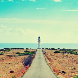 View of beacon Far de Barbaria in Formentera, Balearic Islands, Spain, with a retro effect
