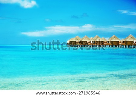 View of beautiful blue ocean water and bungalows in Baros Maldives #271985546