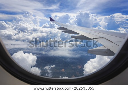 View of beautiful cloud and wing of airplane from window