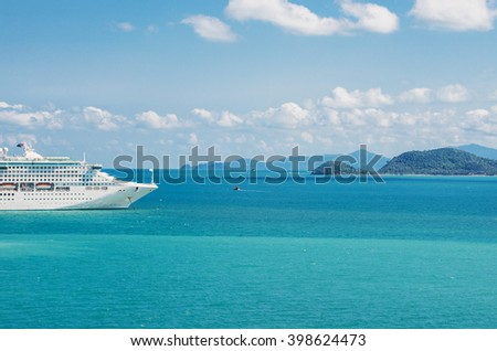 view of beautiful  coastline with anchored cruise ship