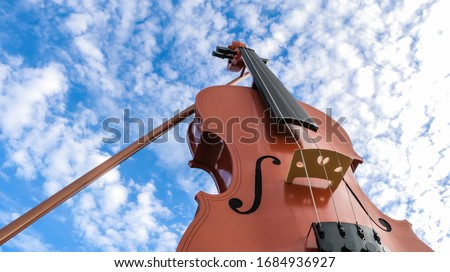 View of beautiful fiddle with blue sky and clouds as background.  Stock fotó ©