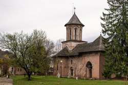 View of beautiful, old monastery in Targoviste, Romania, on a cloudy autumn day