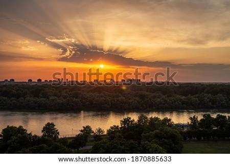 View of beautiful sunset over Zemun, Big War Island and confluense of rivers Danube and Sava, viewed from Kalemegdan fortress in Belgrade, Serbia Stok fotoğraf ©