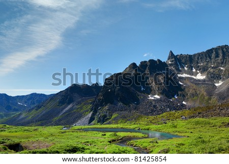 View of beaver dam taken from reverse in Archangel Valley, Alaska. A popular tourist spot for hiking and rock climbing.