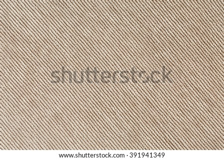 View of Beige Denim Velvet Fabric Texture Background close up diagonal Direction of Threads #391941349