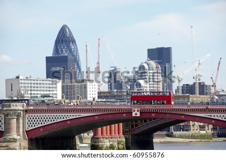 View of Blackfriars bridge with red bus and the city in background