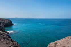 View of blue sea from a viewpoint at Parrot Beach (Papagayo Beach)  - Lanzarote, Canary Islands, Spain