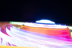 View of blurred motion roller coaster against sky