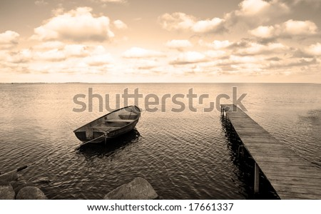 View of boat, bridge and calm sea. Ideal for background. Sepia tone.