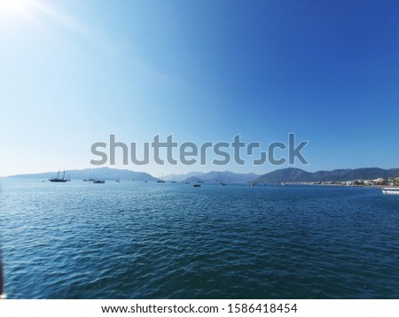 View of Boats and Sea from Marmaris Port City on the Mediterranean Coast, Southwest Turkey, along the Shoreline of the Turkish Riviera on a Sunny Day