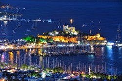 View of Bodrum harbor and Castle of St. Peter by night. Turkish Riviera.