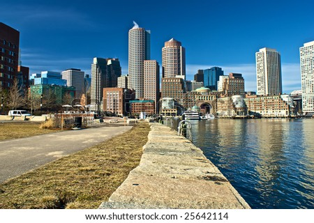 view of boston from harbor and rowes wharf and skyscraper buildings in boston massachusetts