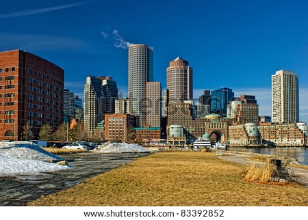 view of boston harbor and rowes wharf and skyscraper buildings in south boston massachusetts in winter.