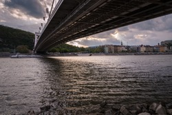 View of Budapest from the bank of Danube river under Elisabeth bridge with the castle in the background, Hungary