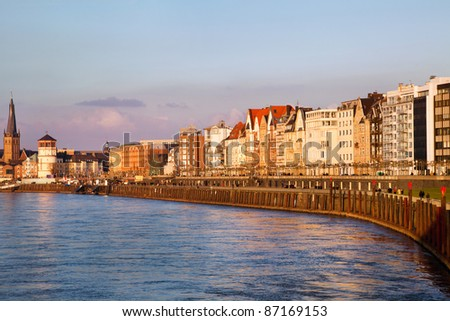 View of building facades of Dusseldorf embankment at the sunset, Germany