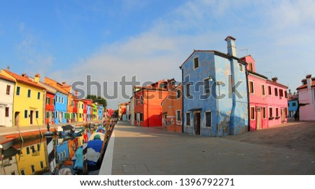 view of Burano Island near Venice in Italy and the painted houses and boats #1396792271