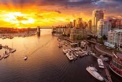 View of Burrard Bridge and False Creek in Downtown Vancouver, British Columbia, Canada. Taken during a beautiful dramatic cloudy sunset. Sky Overlay