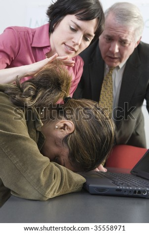View of business people consoling colleague. - stock photo