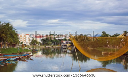 View of busy river in Hoi An, Vietnam. Hoi An is the World's Cultural heritage site, famous for mixed cultures and architecture #1366646630