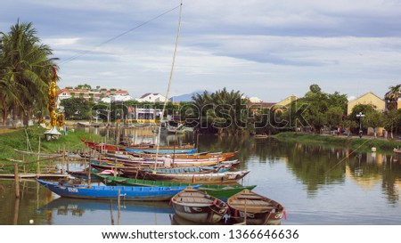 View of busy river in Hoi An, Vietnam. Hoi An is the World's Cultural heritage site, famous for mixed cultures and architecture #1366646636