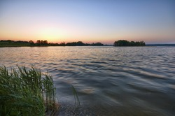 View of calm water surface just before sunrise, Mazury, Poland