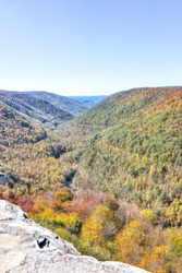 View of canaan valley mountains in Blackwater falls state park in West Virginia during colorful autumn fall season with yellow foliage on trees, rock cliff at Lindy Point