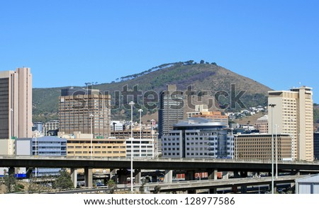 View of Cape Town with Signal Hill in the background - stock photo