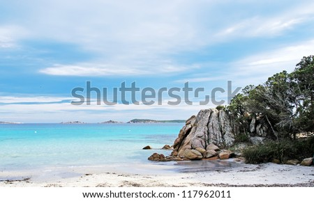 view of Capriccioli beach with rocks on water