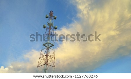 view of Cellular Signal Tower time twilight with colorful of moving clouds and blue sky background #1127768276