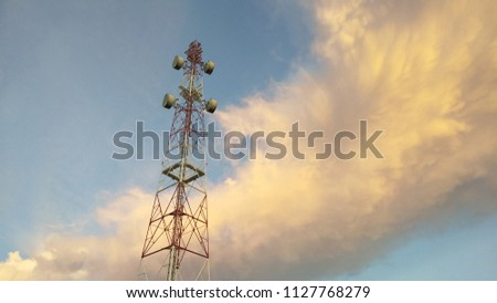 view of Cellular Signal Tower time twilight with colorful of moving clouds and blue sky background #1127768279