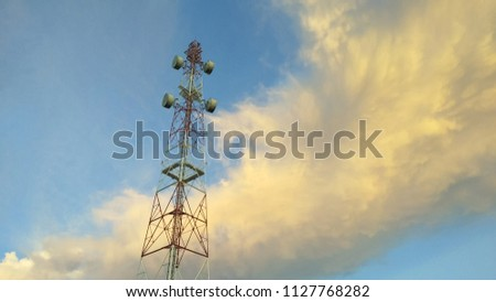 view of Cellular Signal Tower time twilight with colorful of moving clouds and blue sky background #1127768282