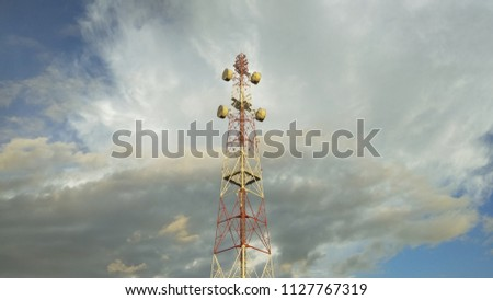 view of Cellular Signal Tower with dark clouds moving background #1127767319
