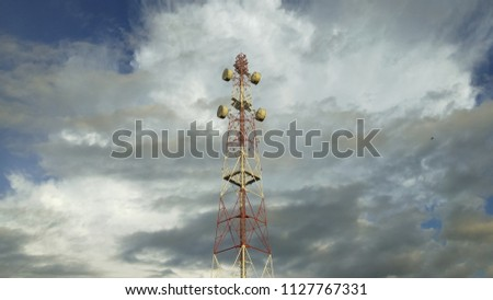 view of Cellular Signal Tower with dark clouds moving background #1127767331