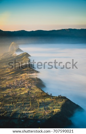 View of Cemara lawang village or Cemoro Lawang; small village in morning mist. Which situated on the edge of massive north-east of Mount Bromo, East Java, Indonesia