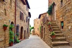 view of characteristic Tuscan stone houses in the village of medieval origin of Monticchiello near Siena, Italy