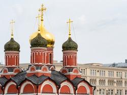 view of church of Znamensky monastery in the Old Tsar's yard from Zaryadye Park on Varvarka street in September