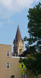View of church steeple, seen from a distance.  Clear, blue sky.  Sunny day.  Fells Point neighborhood (Baltimore, MD).