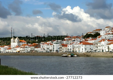 "view of city ""Alcacer do Sal"" near the river ""Sado"" in Portugal"